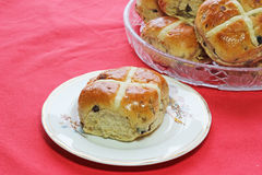 Easter hot cross buns. one on a plate. Royalty Free Stock Photos