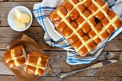 Easter Hot Cross Buns, overhead scene on rustic wood Royalty Free Stock Images