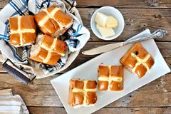 Easter Hot Cross Buns, overhead scene on rustic wood Stock Photo