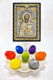 Easter icon. Orthodox easter icon with a candle and the painted eggs Stock Images