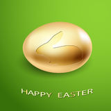 Easter Icon Golden Egg silhouette of a Rabbit on a green backgro Royalty Free Stock Photography