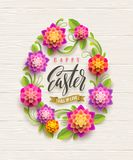 Easter illustration - Easter egg-shaped floral frame with greeting on a wooden background. Easter illustration - Easter egg-shaped floral frame with Stock Photo