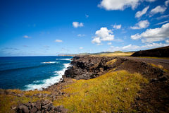Easter Island Coastline. Open space, white waves, deep blue skies Stock Images