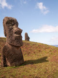 Easter Island Moai. Two moai spread over a hill in Easter Island Stock Photo