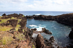 Easter Island rocky coast line under blue sky Royalty Free Stock Photo