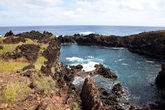Easter Island rocky coast line under blue sky royalty free stock photo