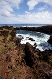 Easter Island rocky coast line under blue sky Royalty Free Stock Images