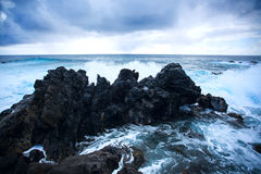 Easter Island rocky coast. The waves of the Pacific Ocean royalty free stock images