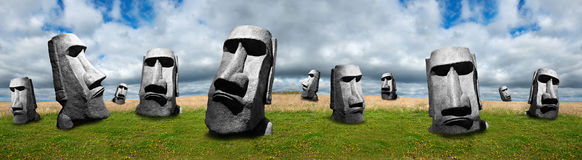 Easter Island Statues, Abstract Panoramic or Panorama Banner. Abstract concept with a series of Easter Island statues in a banner image with a meadow of green royalty free stock photos