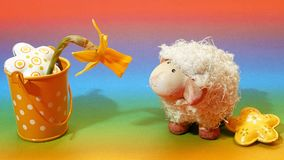 Easter lamb, bucket and flowe royalty free stock images