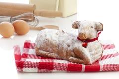 Easter lamb cake and baking utensils royalty free stock photo