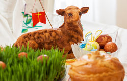 Easter lamb and easter eggs on green grass. On white background Royalty Free Stock Photos