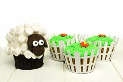 Easter lamb and grass cupcakes Royalty Free Stock Images