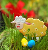 Easter lamb in a green grass - decorated flowerpot.  stock image