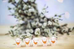 Easter lamb with palm kitten, wooden background. M funny Stock Photography