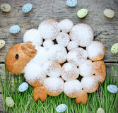 Easter lamb or sheep cake with powdered sugar in green grass wit Stock Photography
