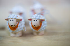 Easter lambs on wooden background Royalty Free Stock Images