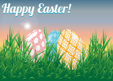 Easter landscape. Decorated Easter eggs in a repeating grass against a rising sun. Stock Image