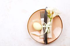 Easter laying table appointments, table setting options. Silverware, tableware items with festive decoration. Fork, knife and flow. Easter table setting Stock Photo