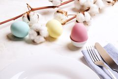 Easter laying table appointments, table setting options. Silverware, tableware items with festive decoration. Fork, knife and flow. Beautiful easter table stock image
