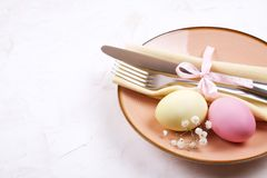 Easter laying table appointments, table setting options. Silverware, tableware items with festive decoration. Fork, knife and flow. Easter table setting Royalty Free Stock Photography