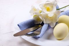 Easter laying table appointments, table setting options. Silverware, tableware items with festive decoration. Fork, knife and flow. Easter table setting Royalty Free Stock Photo