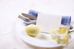 Easter laying table appointments, table setting options. Silverware, tableware items with festive decoration. Fork, knife and flow. Easter table setting Royalty Free Stock Images