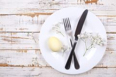 Easter laying table appointments, table setting options. Silverware, tableware items with festive decoration. Fork, knife and flow. Easter table setting Royalty Free Stock Photos