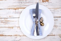 Easter laying table appointments, table setting options. Silverware, tableware items with festive decoration. Fork, knife and flow. Easter table setting Stock Photography