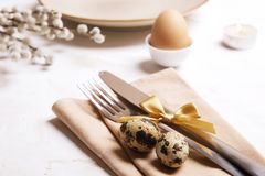 Easter laying table appointments, table setting options. Silverware, tableware items with festive decoration. Fork, knife and flow
