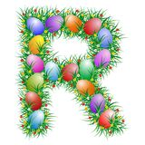 Easter letter - R. Easter text with eggs hidden in the grass stock illustration
