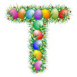 Easter letter - T. Easter text with eggs hidden in the grass royalty free illustration