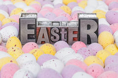 Easter in letterpress and eggs Royalty Free Stock Photography