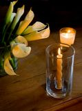 Easter Light. Lilies with candle light. Home interior decor Stock Photos