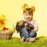 Easter little girl, kid bunny rabbit, basket eggs Royalty Free Stock Photography