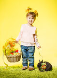 Easter little girl, kid bunny rabbit, basket eggs stock photo