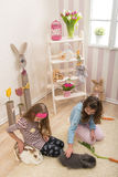 Easter - Little girls stroking the rabbits, hand beets Stock Images