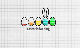 Easter is loading on notepad concept royalty free stock photo