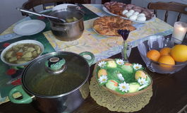 Easter lunch. Special flower-shaped bread, ham, sausage, boiled eggs,soup stock images