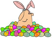 Easter man in a pile of eggs Royalty Free Stock Photos