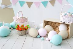 Easter! Many colorful Easter eggs with bunnies and baskets! Easter decoration of the room, children`s room for games. Basket with royalty free stock images