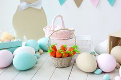 Easter! Many colorful Easter eggs with bunnies and baskets! Easter decoration of the room, children`s room for games. Basket with royalty free stock image