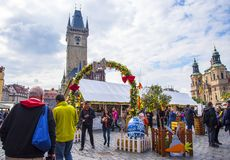 Easter Market on the Old Town Square in Prague in the Czech Republic. The Old Town Square in Prague which has a statue to Christian reformer Jan Hus, the church stock photo