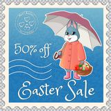 Easter marks mail-03. Postage stamp-discount coupon with an Easter bunny with an umbrella, holds a basket with eggs and cake. He gives a bouquet of tulips. Print royalty free illustration