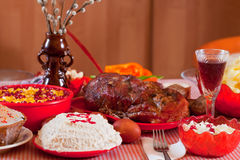 Easter meal. Easter table with celebrate cake and other meal stock image