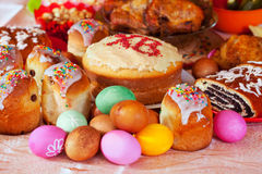 Easter meal. Easter cakes and other meal on festive table Stock Photography