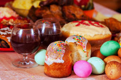 Easter meal. Easter cakes and other meal on festive table Stock Images