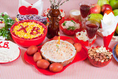 Easter meal. Easter cake and other meal on festive table Stock Photography