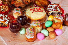 Easter meal. Easter cakes and other meal on festive table Stock Image