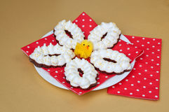 Easter meringue cookies on a white plate with a red napkin Stock Photo